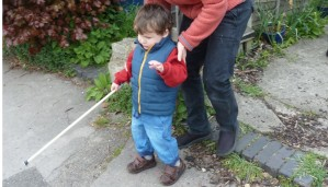 Child with mobility cane